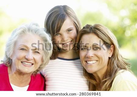 Multi-generation family outdoors - stock photo