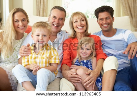Multi Generation Family Relaxing On Sofa At Home