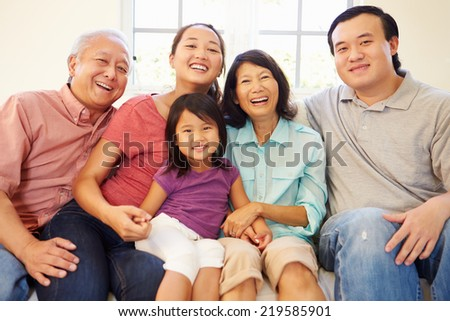 Multi Generation Family Sitting On Sofa At Home Together - stock photo