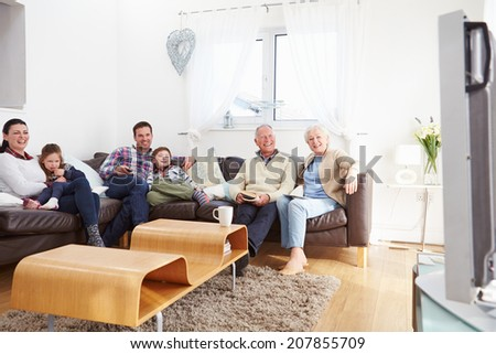 Multi Generation Family Watching TV Together - stock photo