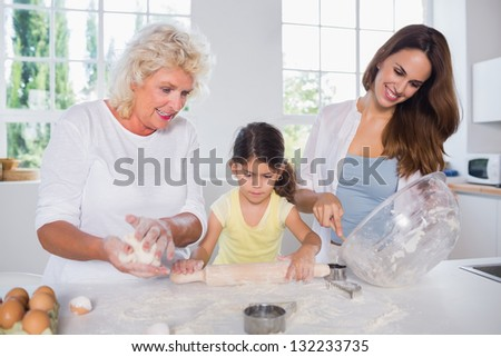 Multi-generation family women baking together in the kitchen - stock photo