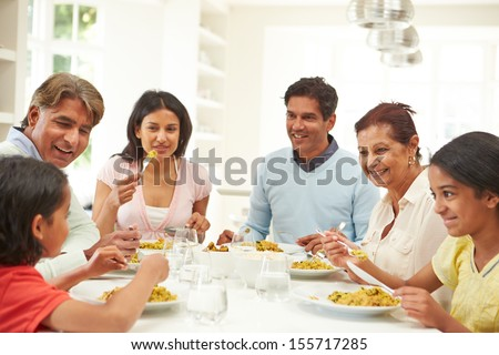 Multi Generation Indian Family Eating Meal At Home - stock photo