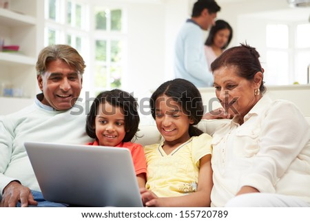 Multi-Generation Indian Family With Laptop - stock photo