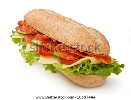Multi-grain calabrese salami sandwich with lettuce, tomatoes and cucumbers - stock photo