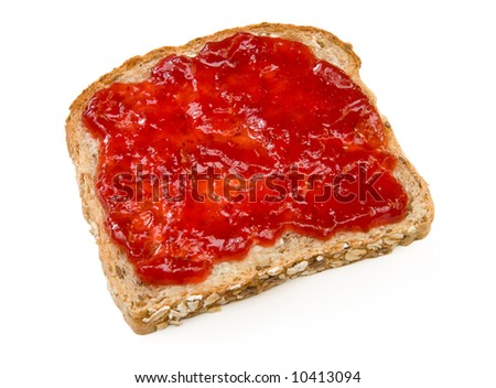 Multi-grain sandwich with butter and strawberry jam - stock photo