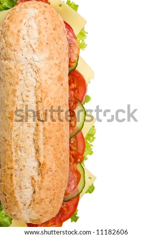 Multi grain submarine sandwich with salami, lettuce, tomatoes and cucumbers, top view, isolated on white background - stock photo