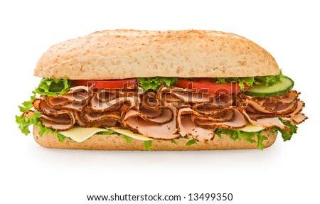 Multi-grain turkey sandwich with lettuce, tomatoes and cheese - stock photo
