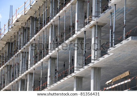 Multi-level commercial high-rise building construction with  blue sky - stock photo