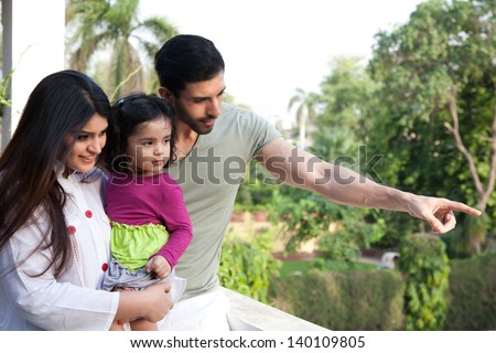 multi racial family of three in outdoor, Indian family - stock photo