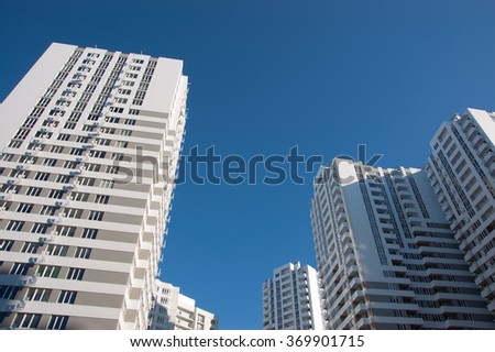 multi-storey buildings in the new house near the town - stock photo