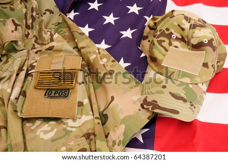 Multicam shirt and cap on US flag - stock photo