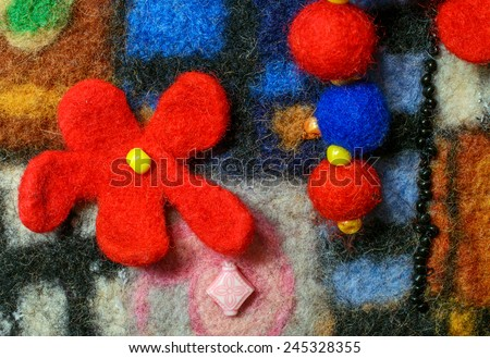 Multicolor abstract fabric texture of wool with flower and  beads .  Craft background - stock photo