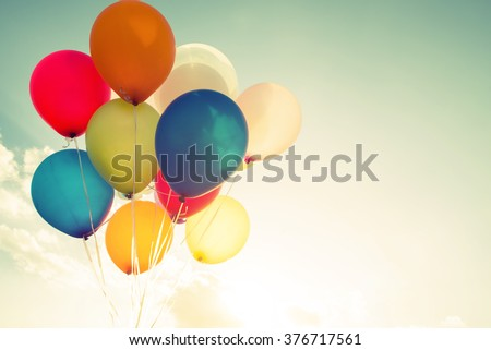 multicolor balloons with a retro instagram filter effect, concept of happy birthday in summer and wedding honeymoon party (Vintage color tone) - stock photo