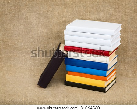 Multicolor books on the canvas background - stock photo