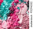 multicolor crushed eyeshadows as a background - stock photo