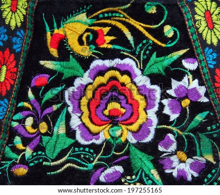 multicolor ethnic handmade embroidery pattern - stock photo