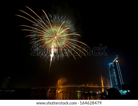 Multicolor fireworks night scene, bangkok cityscape river view, over big bridge