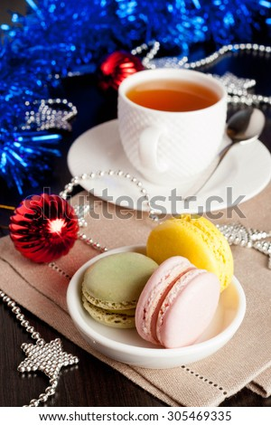 multicolor French macaroons sweet treats Christmas present, vertical