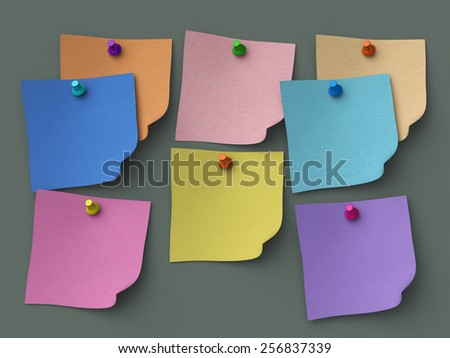 Multicolor notes pinned to gray background - stock photo