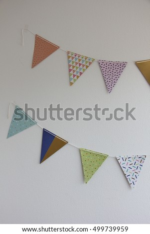 white brick wall decorated by colorful stock photo