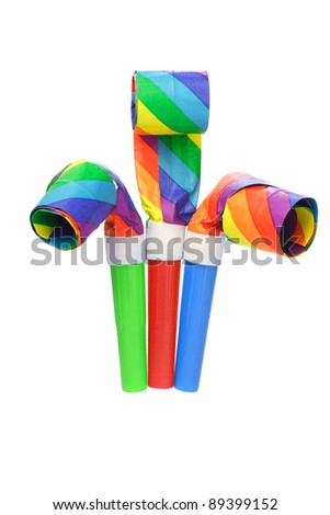 Multicolor party blowers isolated on white background - stock photo