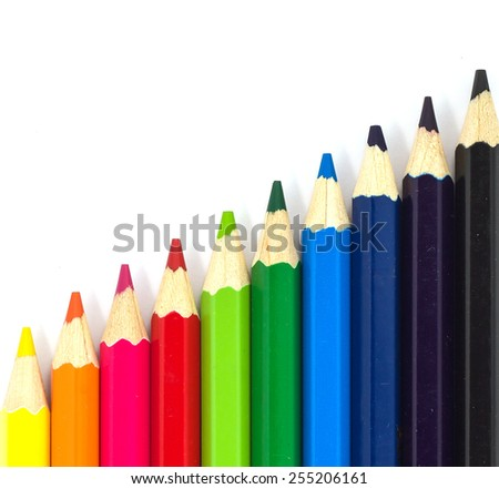 multicolor pencils growing row isolated on white background - stock photo
