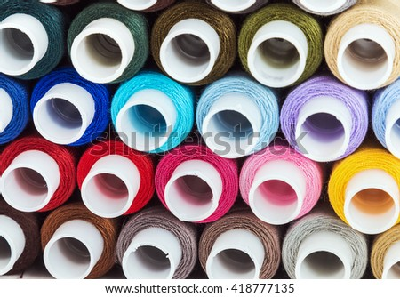 Multicolor sewing threads on background