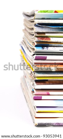 Multicolor stack of magazines isolated on white background - stock photo