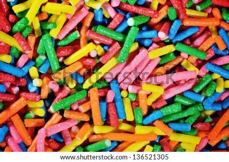 Multicolor sugar sprinkles macro background photo - stock photo