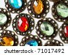 multicolor vintage brooches on white background - stock photo