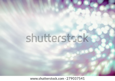 Multicolored abstract background holidays lights in motion blur image - stock photo