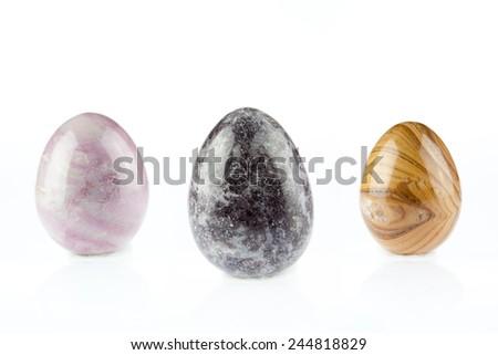 multicolored Agate stones egg shape on white background - stock photo