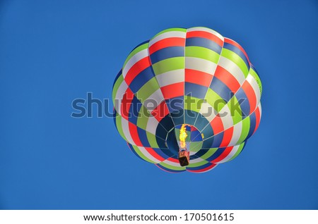 Multicolored and Striped Hot Air Balloon - stock photo