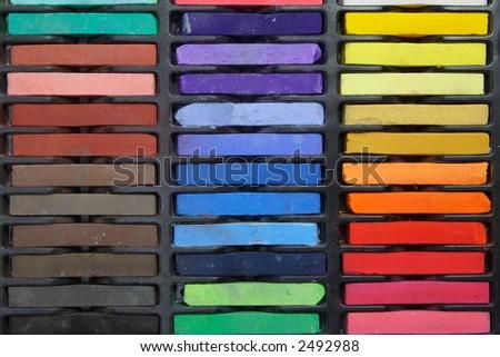 Multicolored artist's pastels (chalk), horizontal - stock photo