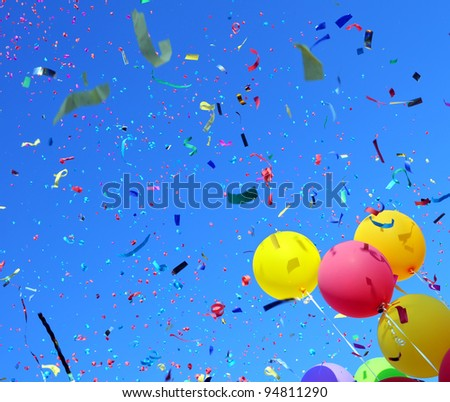 multicolored balloons and confetti in the city festival #3 - stock photo