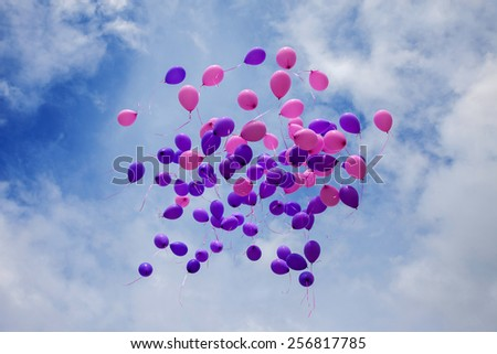 Multicolored balloons on a sky background - stock photo