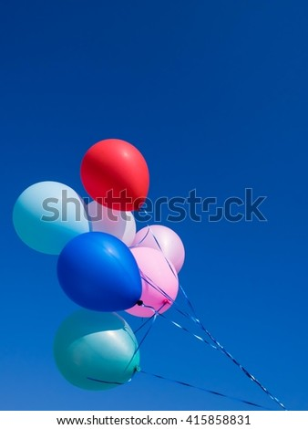 multicolored Balloons with  blue sky. - stock photo