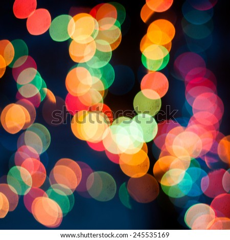 Multicolored bokeh lights background - stock photo