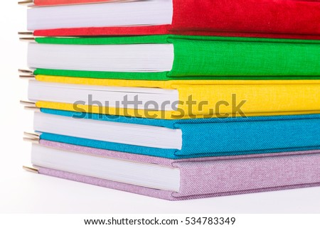 Multicolored book textile cover. Photobooks on a white background.