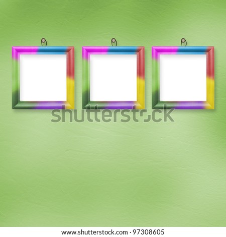 Multicolored bright frames hanging on the abstract pastel background - stock photo