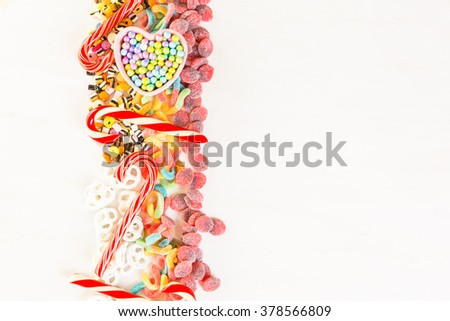 Multicolored candies on a white table.