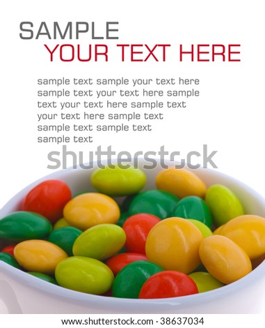 multicolored candy in a cup. isolated on white - stock photo