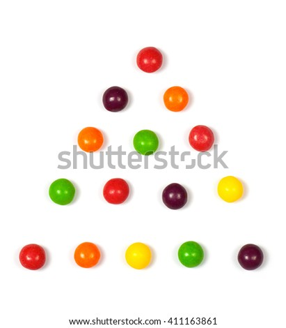Multicolored candy on a white background. Glazed pills. - stock photo