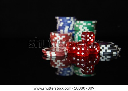 Multicolored casino chips for playing poker - stock photo