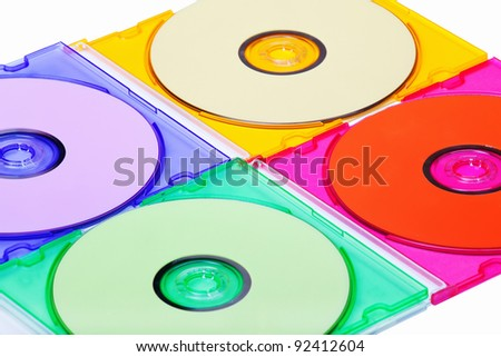 multicolored cd or dvd isolated on white - stock photo