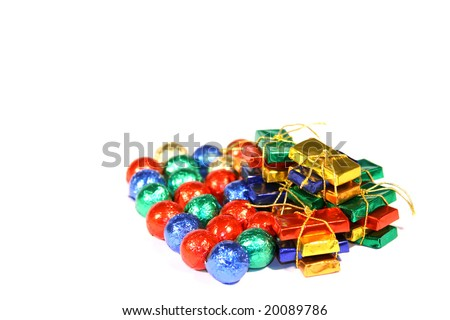 Multicolored Christmas candies on white background (selective focus).