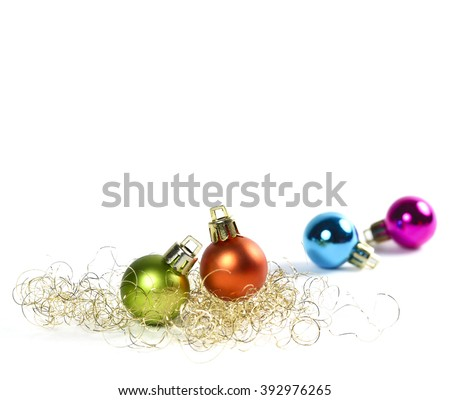 Multicolored christmas tree balls with copy space and glitter. Isolated on white background.