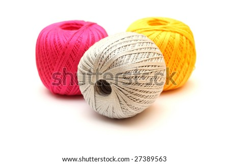 Multicolored clew knitting threads on white background.