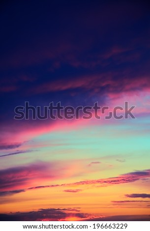 multicolored clouds, sky during sunset, vertical - stock photo