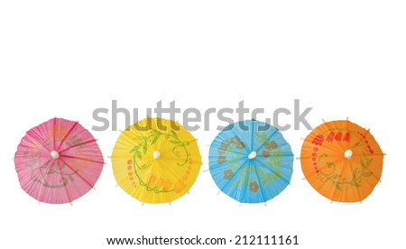 Multicolored Cocktail Umbrellas,isolated on white background  - stock photo